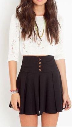 Such a cute skirt! Love highwaisted skirts with a design feature in place of a belt. Also black is my go to color