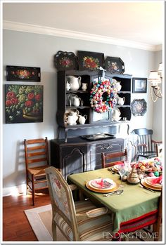 "love the unexpectedness of a buffet on top of a buffet to create a ""hutch"""