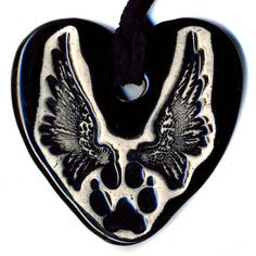 Dog Paw with Wings Ceramic Necklace in Black by surly on Etsy, $18.00