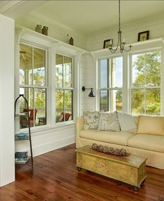 Cheery sunroom with white plank walls