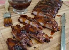Barbecued Baby Back Ribs With Rum.  These start in the oven and end up on the grill... the recipe sounds amazing and I can't wait to try them.