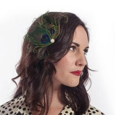 Patty -- Peacock feather vintage style fascinator with pearl and rhinestone accent. $15.00, via Etsy.