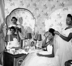 In honor of Black History month 2013.   Today we found the work of  photographer Alonzo Jordon. The photo is of Bonnie Mitchell's wedding preparation with her sister Ida Mae Mitchell.