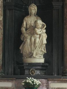 The Madonna of Bruges is a marble sculpture by Michelangelo of Mary with the infant Jesus. The work is notable as the only sculpture by Michelangelo to leave Italy during his lifetime. It was bought by Giovanni and Alessandro Moscheroni (Mouscron), from a family of wealthy cloth merchants in Bruges. The sculpture was sold for 4,000 florin.The sculpture was removed twice from Belgium: during the French Revolution and World War II. It now sits in the Church of Our Lady in Bruges, Belgium.  AT
