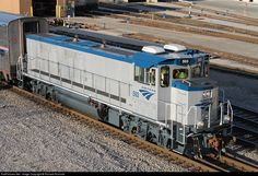 RailPictures.Net Photo: AMTK 593 Amtrak MPI MP14B at Chicago, Illinois by Richard Rosinski. - The MPI MP14B is a low-emissions diesel switcher locomotive built by MotivePower Industries. It is powered by two Cummins QSK19C I6 engines with each one developing 700 horsepower (522 kW) and creating a total power output of 1,400 horsepower (1,040 kW).  The MPI MP14B is nearly identical to the MPI MP21B except that it has one fewer engine.