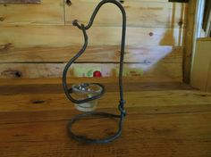 Hand forged iron candle holder by Ironcladforgeandfarm on Etsy