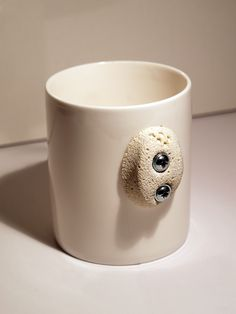 the 'cliff hanger mug' by the play coalition.  a great gift for the rock climbing enthusiast!