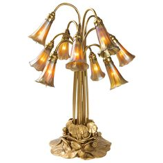 Tiffany Studios Gilt Ten-Light Lily Lamp | From a unique collection of antique and modern table lamps at https://www.1stdibs.com/furniture/lighting/table-lamps/
