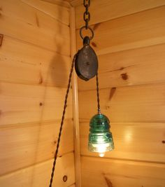 Industrial Pulley & Vintage Insulator Swag Light. Very Cool