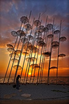 "Sunset at Thessaloniki, Macedonia_ Greece. ""De Umbrellas"" is a work of art by George Zoggolopoulos n it stands on de New Promenade of de city of Thessaloniki, since 1997 when de city was Cultural Capital of Europe. Albania, Poesia Visual, Image Nature, Umbrella Art, Parasols, Outdoor Art, Photos Of The Week, Greece Travel, Public Art"