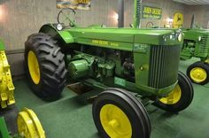 John Deere two cylinder model R, John Deere's first diesel powered tractor. Hard to believe that when this tractor was introduced in 1949 it was the largest tractor John Deere offered, both in physical size and horsepower at a whopping 49.
