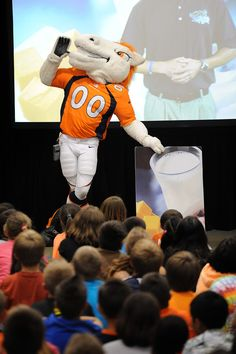 "Miles, Denver Broncos mascot, raises excitement Sept. 3 for ""Fuel Up to Play 60"" at Ridgeview Elementary School in Falcon School District 49. Teacher Marvra Winner is the adult adviser for the school's student-led participation in Fuel Up to Play 60, a program founded by the NFL and National Dairy Council. It empowers students to eat healthy and complete 60 minutes of exercise every day."