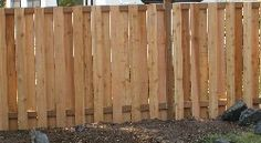 A cheap fence; not bad.  This is so going up in the back end of our yard... then I can do a garden wall..
