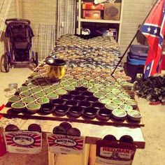 Ultimate beer pong table my friends and I made with dip cans. Rebel flag. Merica. Chew. Mud jug. DIY