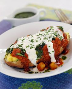 Easy Indian Food: Indian Stuffed Potato Chaat  - A baked potato stuffed with vegan yogurt turmeric mash smothered in chickpea curry and topped with mint chutney and more vegan yogurt! | HealthySlowCooking.com