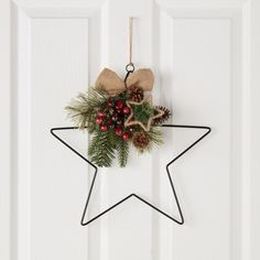 This geometric star is a great way to bring the outdoors inside this Christmas. The red berries, fir tree sprigs and pine cone adornments will add a festive feel to any door, and every person who walks through it. Noel Christmas, Rustic Christmas, All Things Christmas, Simple Christmas, Handmade Christmas, Christmas Ornaments, Xmas Wreaths, Xmas Crafts, Diy Wreath