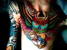 Colorful Owl on Chest Tattoo Idea