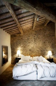 57 Exposed stone wall ideas for a modern interior You want to have a classy interior, retro and modern? If this is the case, we suggest you start with the walls. The exposed stone wall is increasingly preferred in contemporary design. Barn Bedrooms, Master Bedrooms, Modern Interior, Interior Design, Stone Interior, Interior Walls, Italian Home, Rustic Italian, Farmhouse Master Bedroom