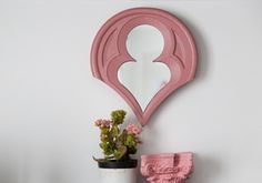 Mirror in pink color. Classical design. Details for Home