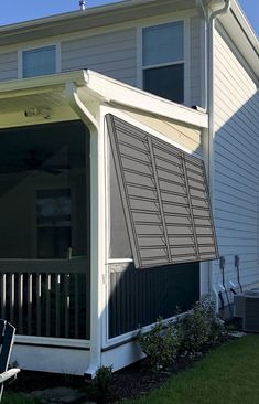 I went on the hunt to find Bahama shutters that fit the bill. Have you ever priced Bahama shutters? These shutters needed to be 70 inches tall and span a gap of 141 inches wide which meant custom shutters and that bill came to Custom Shutters, Diy Shutters, Window Shutters, Bermuda Shutters, Bahama Shutters, Patio Fence, Deck Pergola, Porch Overhang, Outdoor Shutters