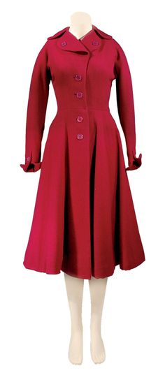 Mainbocher Raspberry Wool Coat   American, 1950s   Fitted bodice with rounded notched collar, long kimono sleeve with gusset and turn back cuffs, gored skirt, buttons down center front closure and on lapels and cuffs, black silk lining
