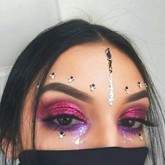 Rave festival makeup outfit pink purple glitter face gems