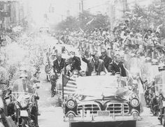 Apollo 11 astronauts Neil Armstrong, Buzz Aldrin and Michael Collins wave to crowds during a parade celebrating their return from the moon, August 1969.