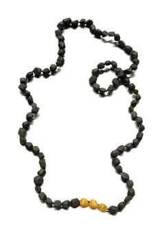 "Lavinia Rossetti  -Lattex sponge, acrylic color, bronze, gold leaf. Alchimia - at Joya 2012 (this necklace has a ""secret"" : all beads are black, but some are heavier than others because of different materials ...)"