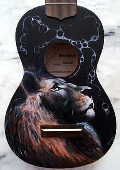 Hand painted ukulele Лев на гитаре Leo on guitar Dedicated to ukulele lovers 🎸Tienda Online UkuleleFis 🎸Ukeleles 👕T-shirt 📽 Video in Ukulele Art, Guitar Art, Cool Guitar, Acoustic Guitar, Ukelele Painted, Painted Guitars, Guitar Painting, Beautiful Guitars, Guitar Design