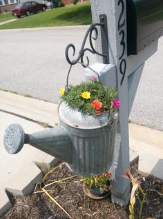 YARD – Great idea to add curb appeal to the front yard! Mailbox post with a watering can planter. Cute idea to hang something decorative on the back of the post! Mailbox Garden, Mailbox Landscaping, Mailbox Post, Lawn And Garden, Mailbox Planter, Landscaping Ideas, Mailbox Ideas, Mulch Landscaping, Landscaping Software