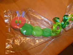 Hungry caterpillar cookie favors by Mercibeaucookies.blogspot.com