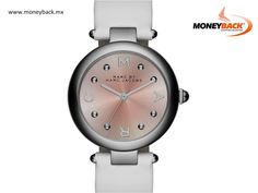 Marc Jacobs Dotty Band 34 MM features a genuine leather strap with adjustable closure, a stainless steel 34MM case in various finishes, and a 3-hand movement. New to the Marc Jacobs collection, the Dotty watch showcases circular details, including a rounded case, curved lug, and dotted index. An illuminating sunray dial adds a touch of shine. #taxfree