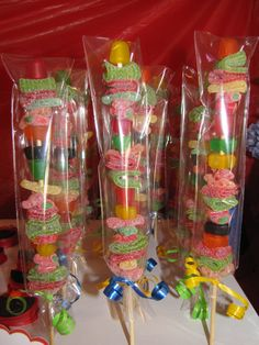 Candy on a stick, this was a pain to put on the stick. Used all kinds of gummy candies. Bagged then used a ribbon to tie off bottom.