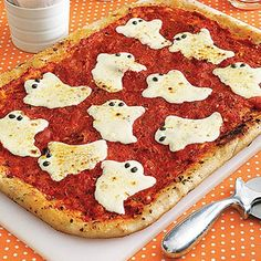 A ghost shaped cookie cutter will do the trick! The cheese tends to melt and turn into a big blob if baked too long, so bake your pizza first, then add the cheese 5 min before it's done. Use olives to make the eyes!