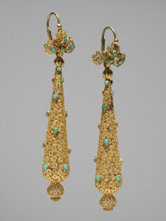 Earrings of delicate coiled filigree gold wire in set with turquoise; French, circa1820-70.