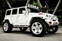 Lifted Snow White #Jeep ... Rocking a set of rockstar wheels. What are your thoughts?  #Love the build?  REPIN!  http://www.wheelhero.com/topics/Jeep-Wheels-For-Sale