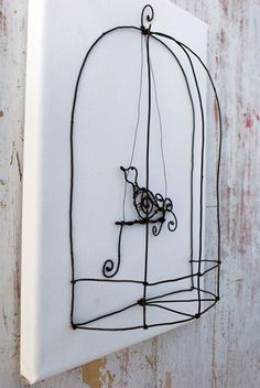 bird in a cage by WireDreams on Etsy