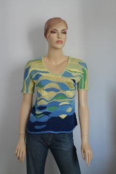 This is an exclusive Sweater - Top, performed in technique Freeform w ith accent - texture of the sweater. Design by Levintovich.  You can wear it on