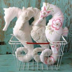 if i could cut a stencil of a seahorse then cut out fabric in that shape and stuff it and sew it and then draw on it. STUFFED SEAHORSIES