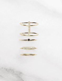 Vrai & Oro ring collection: Solid gold and diamonds, beautiful minimalist designs, made in the U.S...without the retail markups. We believe in quality over quantity, and only buying things that last, which is why we set out to making fine jewelry more attainable. See @vraiandoro for the latest designs.