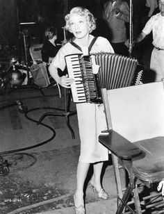 "Marlene Dietrich entertains on the set of ""Witness for the Prosecution"" (1957, Billy Wilder)."