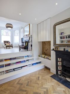 Books can be stored beneath the steps of the staircase in this renovated London flat