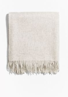 Sumptuously voluminous and divinely warming, this soft wool scarf is a timeless wardrobe essential.