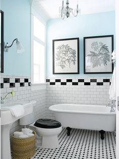 Pale blue walls, black toilet seat, white walls black frames