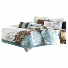 Showcasing a bold floral motif with pops of blue, this cotton sateen comforter set brings eye-catching style to your bedroom decor.