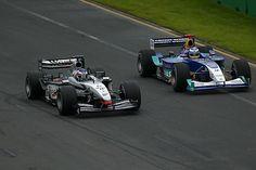 Kimi Raikkonen (FIN) McLaren Mercedes MP4/17D overtakes Nick Heidfeld (GER) Sauber Petronas C22 Formula One World Championship, Rd1, Australian Grand Prix, Race Day, Albert Park, Melbourne, Australia, 9 March 2003