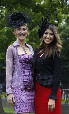 Leslie McMullen from California, left, and Marlo Greta from Texas pose for a photograph on the fourth day of the Royal Ascot horse race meeting at Ascot, England, Friday, June 17, 2011. When in England...wear a crazy hat, or you wont fit in ;)