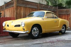 Yellow Karmann Ghia. My mom's was a green. Loved that car!