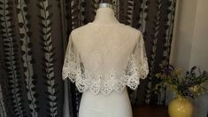 This listing is for one BRIDAL LACE CAPELET FEATURES: - This bridal cape/cover up is made of beautiful soft lace - with beaded lace trim on edge - is in OFF-WHITE - An Ideal addition to your strapless wedding gown ONE SIZE fits the most Actual colors may slightly vary due to the