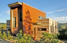 Colorado-based Studio H:T designed this Shipping Container House in 2010. It is made of two 40 foot Shipping Containers. The project is planned to be off-the-grid using solar orientation, passive cooling, green roofs, pellet stove heating and photovoltaics to create electricity.